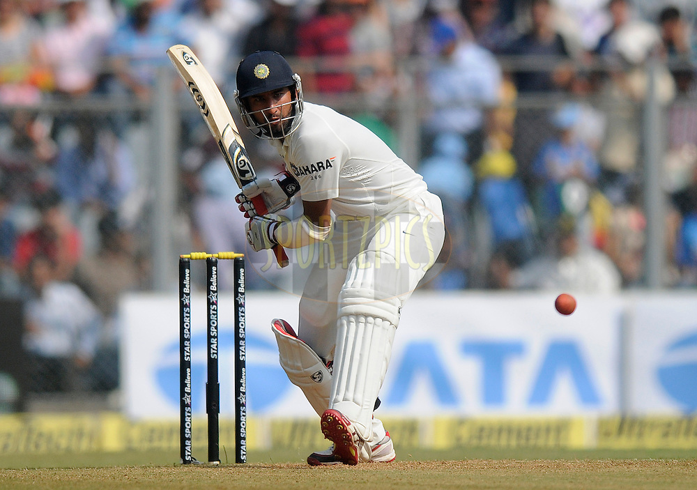 Cheteshwar Pujara of India bats during day two of the second Star Sports test match between India and The West Indies held at The Wankhede Stadium in Mumbai, India on the 15th November 2013<br /> <br /> This test match is the 200th test match for Sachin Tendulkar and his last for India.  After a career spanning more than 24yrs Sachin is retiring from cricket and this test match is his last appearance on the field of play.<br /> <br /> <br /> Photo by: Pal PIllai - BCCI - SPORTZPICS<br /> <br /> Use of this image is subject to the terms and conditions as outlined by the BCCI. These terms can be found by following this link:<br /> <br /> http://sportzpics.photoshelter.com/gallery/BCCI-Image-Terms/G0000ahUVIIEBQ84/C0000whs75.ajndY