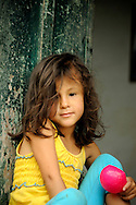 A girl in her stoop in Salento, Colombia..
