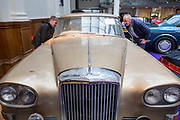 UNITED KINGDOM, London: 24 April 2018 Father and son Adam Dornan, aged 12 and Dermot Dornan take a closer look at a rusty 1963 Bentley Continental Mulliner Park Ward S3 which was found in an underground garage. The car forms part of the Spring Classics: An Important Auction of Fine Historic Automobiles at The Royal Horticultural Halls, Westminster. The auction will see a collection of privately owned cars be auctioned this evening April 24th 2018. Rick Findler  / Story Picture Agency