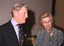 The HON.SIR ANGUS OGILVY and his wife PRINCESS ALEXANDRA, at a party in London on 14th October 1998.MKU 49
