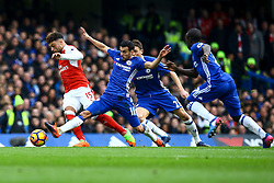 Pedro of Chelsea stretches to tackle Alex Oxlade-Chamberlain of Arsenal - Mandatory by-line: Jason Brown/JMP - 04/01/2017 - FOOTBALL - Stamford Bridge - London, England - Chelsea v Arsenal - Premier League