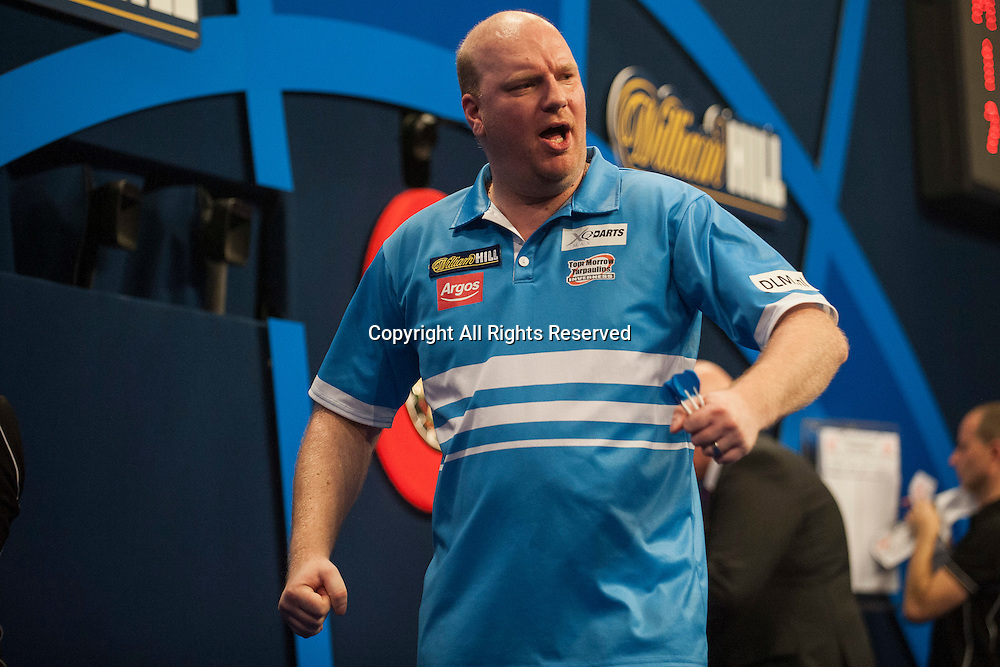 02.01.2014.  London, England.  William Hill PDC World Darts Championship.  Quarter Final Round.  Vincent van der Voort (23) [NED] celebrates during his game with Phil Taylor (2) [ENG]. Phil Taylor won the match 5-3