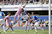 Reading defender Jake Cooper (35) jumps high to win a header during the Sky Bet Championship match between Queens Park Rangers and Reading at the Loftus Road Stadium, London, England on 23 April 2016. Photo by Andy Walter.