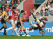 Twickenham, GREAT BRITAIN,  Harlequins', Jim EVANS turned over by Sarries Kameli RATUVOU tackle during the Guinness Premiership match Harlequins vs Saracens at The Stoop Stadium, Surrey on Sat. 19.09.2009.  [Photo. Peter Spurrier/Intersport-images]