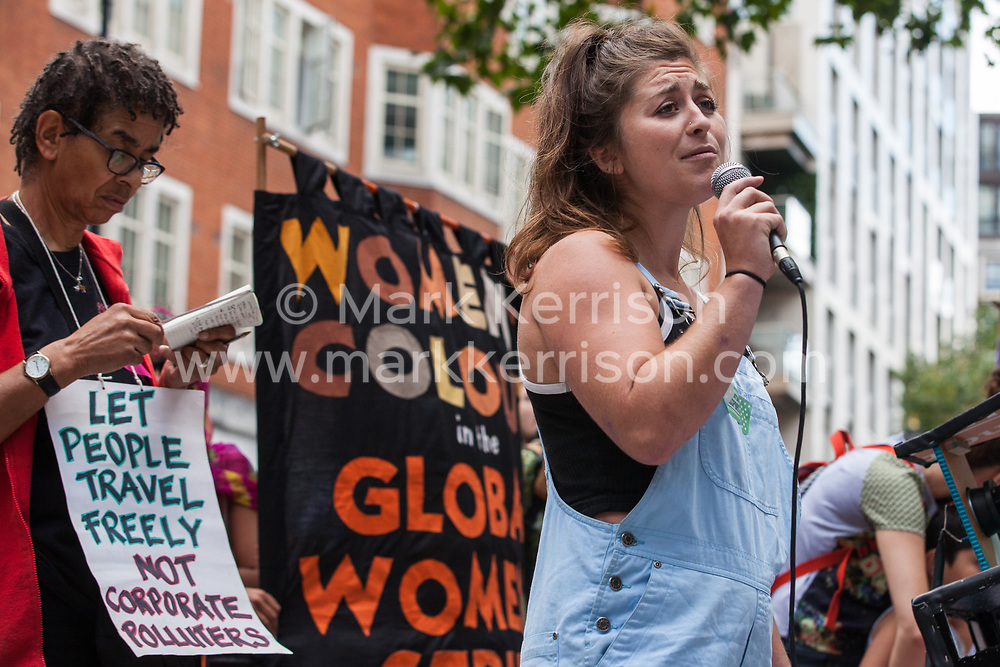 London, UK. 29 July, 2019. A speaker from Docs Not Cops addresses activists from Reclaim the Power, All African Women's Group, Docs Not Cops, Lesbians and Gays Support the Migrants and other groups at a protest outside the Home Office to demand an end to the Government's 'hostile environment' policies.