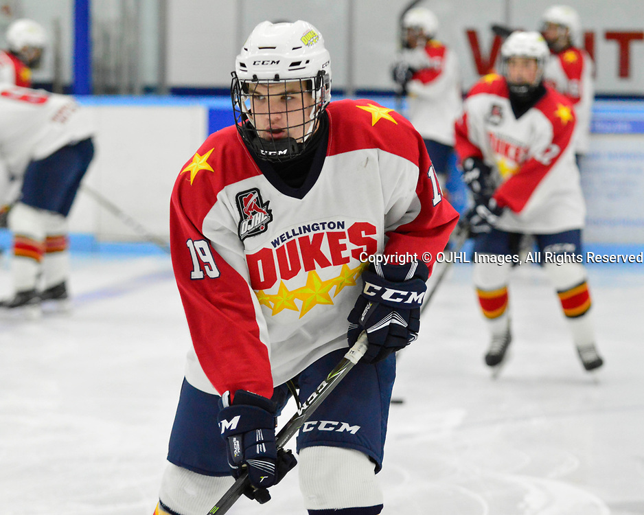 MARKHAM, ON  - SEP 16,  2017: Ontario Junior Hockey League game between the Markham Royals and the Wellington Dukes, Jeffrey Burridge #19 of the Wellington Dukes participates in the pre-game warmup.<br /> (Photo by Abhinav Nirula / OJHL Images)