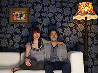 Couple embracing sitting on sofa portrait