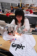 4/3/09 10:49:32 AM -- Easton, PA, U.S.A. -- Barbara Graver, a seamstress at Majestic Athletic sews lettering on the back of a Chicago White Sox jersey April 3, 2009 in Easton, Pennsylvania. White Sox jerseys and gear have experienced a boost in sales with Obama, a White Sox fan, in the White House. -- .Photo by William Thomas Cain,  cainimages.com.