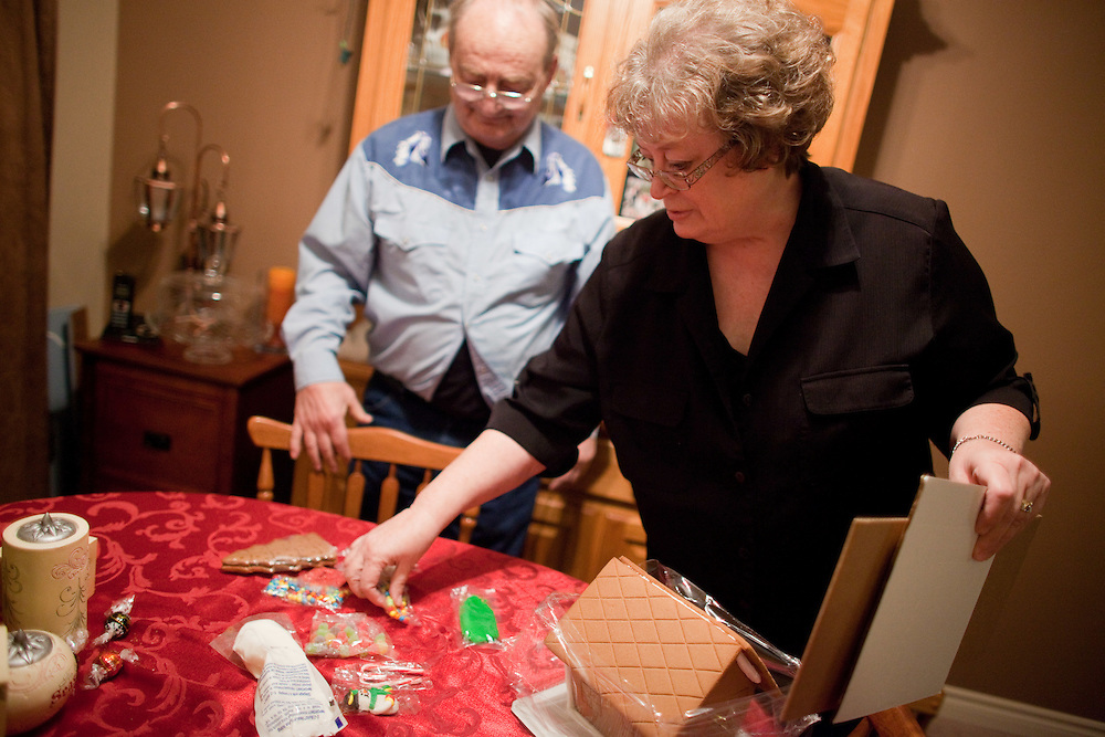 Jim and Linda Finkbeiner  start to work on a gingerbread house, part of the couple's Christmas preparations in their Exeter, Ontario home, Tuesday, December 13, 2011. Jim suffers from early-stage Alzheimer's and he and Linda, his primary caregiver, do what they can to minimize the additional stresses on Jim's condition that the holiday season can create. THE CANADIAN PRESS/ Geoff Robins
