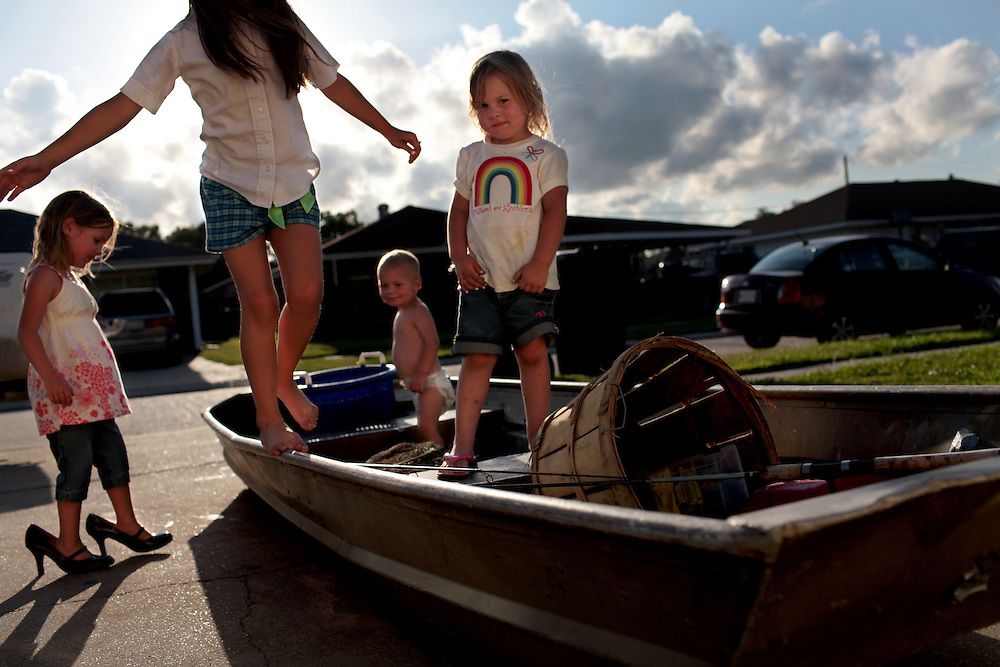 Sisters Gabbrielle Melerine, 4, left, Hailey Melerine, 7, Jason Melerine Jr., 2, and Hannah Melerine, 3, center, play on one of their father Jason Melerine's fishing boats in Poydras, St Bernard Parish, LA on May 20, 2010. The Melerine family origially settled in the area in the 1700's and have been fishermen in the area through the generations. Captain Eric Melerine crew on his crab boat include his brother Jason Melerine and cousin Lance Melerine, all affected by the BP oil spill in the Gulf of Mexico with the oil threatening to the shut down the entire fishing industry.
