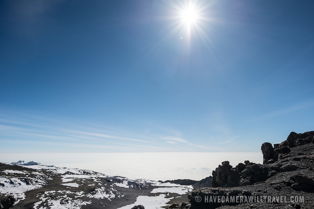 Looking out over the clouds from the summit of Mt. Kilimanjaro, with clouds far below.