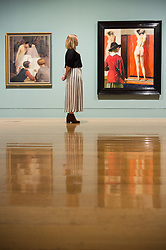 © Licensed to London News Pictures. 03/04/2017. Museum staff views a painting titled Self Portrait by artist Laura Knight showing as part of Tate Britain's Queer British Art exhibition. London, UK. Photo credit: Ray Tang/LNP