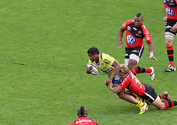 Jonny Wilkinson of Toulon tackles Wesley Fofana of Clermont during the French Top 14 Semi Final match between ASM Clermont Auvergne and RC Toulon at the Stade Municipal on June 3, 2012 in Toulouse, France.