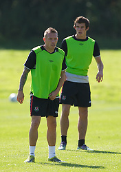 CARDIFF, WALES - Tuesday, August 31, 2010: Wales' captain Craig Bellamy and Gareth Bale during training at the Vale of Glamorgan ahead of the UEFA Euro 2012 Qualifying Group 4 match against Montenegro. (Pic by David Rawcliffe/Propaganda)