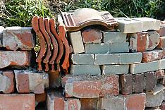 Hergebruik van stenen in natuurrijke tuin