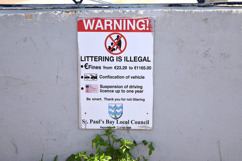 Littering is illegal sign with fines