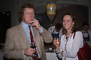 Mr. and Mrs. Ranald Macdonald yr of Clanranald . The Tatler Restaurant Awards in association with  Louis Roederer champagne.  The Four Seasons Hotel, Hamilton Place, London. 10 January 2004. ONE TIME USE ONLY - DO NOT ARCHIVE  © Copyright Photograph by Dafydd Jones 66 Stockwell Park Rd. London SW9 0DA Tel 020 7733 0108 www.dafjones.com