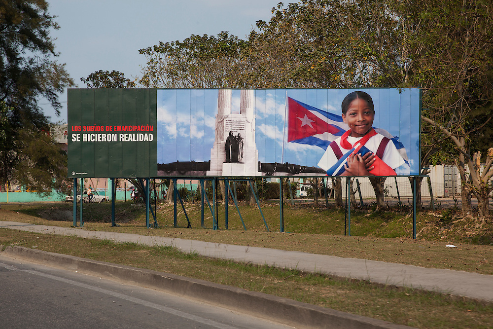 "Large advertising billboard claiming ""The emancipation dreams came true"" along a road outside Havana, Cuba."