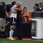 Abby Wambach, USA, is congratulated by coach Tom Sermanni after becoming the greatest goal scorer in international soccer. Wambach scored four goals during the U.S. Women's 5-0 victory over Korea Republic, friendly soccer match. The four goals brings her tally to 160 goals which eclipsed Mia Hamm's all-time goal record of 158 goals.  Red Bull Arena, Harrison, New Jersey. USA. 20th June 2013. Photo Tim Clayton