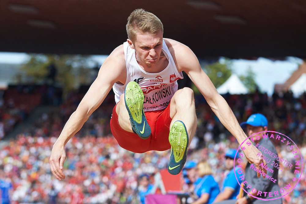 Adrian Strzalkowski from Poland competes in men's long jump final during the Sixth Day of the European Athletics Championships Zurich 2014 at Letzigrund Stadium in Zurich, Switzerland.<br /> <br /> Switzerland, Zurich, August 17, 2014<br /> <br /> Picture also available in RAW (NEF) or TIFF format on special request.<br /> <br /> For editorial use only. Any commercial or promotional use requires permission.<br /> <br /> Photo by &copy; Adam Nurkiewicz / Mediasport