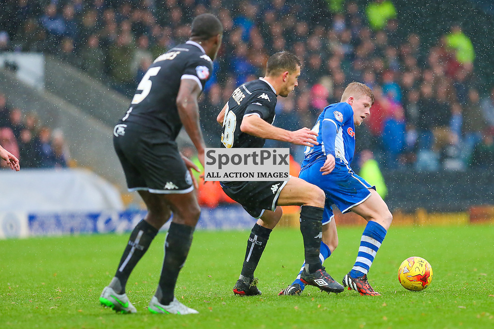 Andy Cannon in action with Jason Pearce and Donavon Daniels during Rochdale v Wigan Athletic , Sky Bet League One Match, 14 November 2015<br /> Picture by Jackie Meredith/SportPix.org.uk