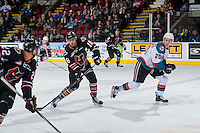 KELOWNA, CANADA - FEBRUARY 1: Murphy Stratton #18 of the Calgary Hitmen passes the puck against the Kelowna Rockets on February 1, 2017 at Prospera Place in Kelowna, British Columbia, Canada.  (Photo by Marissa Baecker/Shoot the Breeze)  *** Local Caption ***