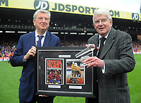 Football - 2017 / 2018 Premier League - Crystal Palace vs. West Bromwich Albion<br /> <br /> BBC Football commentator is presented with a framed photo and Glass Microphone after his last game before retiring,by Crystal Palace manager, Roy Hodgson at Selhurst Park.<br /> <br /> COLORSPORT/ANDREW COWIE