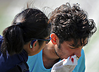 23 September 2011: Glendale College goal keeper Hakob Boghossian is attended to by a Orange Coast College trainer after sustaining an injury. Orange Coast defeated Glendale 6 to 0.