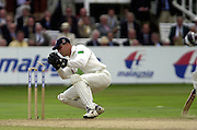Photo Peter Spurrier.31/08/2002.Cheltenham & Gloucester Trophy Final - Lords.Somerset C.C vs YorkshireC.C..Yorkshire batting;  Matt Elliott. and Michael Vaughan.Somerset's wicketkeeper collects the ball after it clips the stumps.