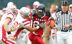 11.07.2011, UPC Arena, Graz, AUT, American Football WM 2011, Group B, Canada (CAN) vs Austria (AUT), im Bild Johannes Neusser (Austria, #7, DB) and Simon Blach (Austria, #49, LB) try to stop Shamawd Chambers (Canada, #84, R)  // during the American Football World Championship 2011 Group B game, Canada vs Austria, at UPC Arena, Graz, 2011-07-11, EXPA Pictures © 2011, PhotoCredit: EXPA/ T. Haumer