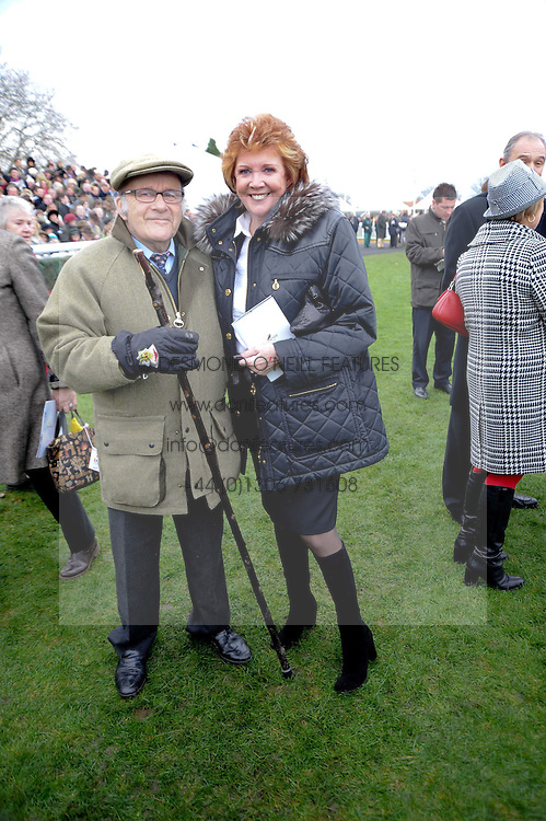 CILLA BLACK & LORD OAKSEY at the Hennessy Gold Cup 2009 held at Newbury Racecourse, Berkshire on 28th November 2009.