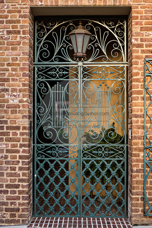 Decorative iron gate on the Old Dock Street Theatre in Charleston, SC.