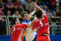 David Miklavcic of Slovenia between Blazenko Lackovic of Croatia and Domagoj Duvnjak of Croatia during handball match between Slovenia and Croatia in  2nd Round of Preliminary Round of 10th EHF European Handball Championship Serbia 2012, on January 18, 2012 in Millennium Center, Vrsac, Serbia. Croatia defeated Slovenia 31-29. (Photo By Vid Ponikvar / Sportida.com)