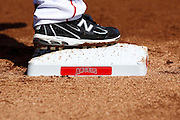 ANAHEIM, CA - APRIL 07:  First base shows the team name while surrounded by dirt as a player rounds first base at the Los Angeles Angels of Anaheim game against the Kansas City Royals on Saturday, April 7, 2012 at Angel Stadium in Anaheim, California. The Royals won the game 6-3. (Photo by Paul Spinelli/MLB Photos via Getty Images)