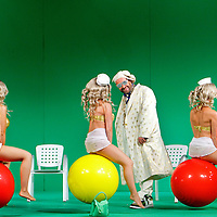 Picture shows : Adrian Powter as Taddeo with bunny girls...Picture  ©  Drew Farrell Tel : 07721 -735041..A new Scottish Opera production of  Rossini's 'The Italian Girl in Algiers' opens at The Theatre Royal Glasgow on Wednesday 21st October 2009..(Soap) opera as you've never seen it before.Tonight on Algiers.....Colin McColl's cheeky take on Rossini's comic opera is a riot of bunny girls, beach balls, and small screen heroes with big screen egos. Set in a TV studio during the filming of popular Latino soap, Algiers, the show pits Rossini's typically playful and lyrical music against the shoreline shenanigans of cast and crew. You'd think the scandal would be confined to the outrageous storylines, but there's as much action off set as there is on.... .Italian bass Tiziano Bracci makes his UK debut in the role of Mustafa. Scottish mezzo-soprano Karen Cargill, who the Guardian called a 'bright star' for her performance as Rosina in Scottish Opera's 2007 production of The Barber of Seville, sings Isabella. .Cast .Mustafa...Tiziano Bracci.Isabella..Karen Cargill.Lindoro...Thomas Walker.Elvira...Mary O'Sullivan.Zulma...Julia Riley.Haly...Paul Carey Jones.Taddeo...Adrian Powter. .Conductors.Wyn Davies.Derek Clarke (Nov 14). .Director by Colin McColl.Set and Lighting Designer by Tony Rabbit.Costume Designer by Nic Smillie..New co-production with New Zealand Opera.Production supported by.The Scottish Opera Syndicate.Sung in Italian with English supertitles..Performances.Theatre Royal, Glasgow - October 21, 25,29,31..Eden Court, Inverness - November 7. .His Majesty's Theatre, Aberdeen  - November 14..Festival Theatre,Edinburgh - November 21, 25, 27 ...Note to Editors:  This image is free to be used editorially in the promotion of Scottish Opera. Without prejudice ALL other licences without prior consent will be deemed a breach of copyright under the 1988. Copyright Design and Patents Act  and will be subject to payment or legal action, where appropriate..Further further info
