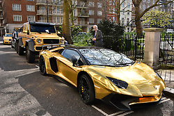 © Licensed to London News Pictures. 31/03/2016. London, UK. A fleet of supercars including a six-wheel £370,000 Mercedes G63, a £350,000 Bentley and a £350,000 Lamborghini Aventador SV are covered in gold chrome wrap parked in Knightsbridge, London on Wednesday, 31 March 2016. Cars are believed to be owned by Saudi billionaire Turki Bin Abdullah .Photo credit: Ray Tang/LNP