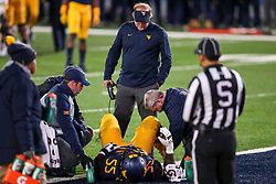 Nov 23, 2018; Morgantown, WV, USA; West Virginia Mountaineers head coach Dana Holgorsen watches as West Virginia Mountaineers offensive lineman Yodny Cajuste (55) is injured during the third quarter against the Oklahoma Sooners at Mountaineer Field at Milan Puskar Stadium. Mandatory Credit: Ben Queen-USA TODAY Sports