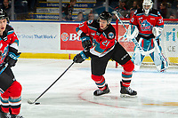 KELOWNA, BC - NOVEMBER 1: Jake Lee #21 of the Kelowna Rockets skates with the puck against the Prince George Cougars  at Prospera Place on November 1, 2019 in Kelowna, Canada. (Photo by Marissa Baecker/Shoot the Breeze)