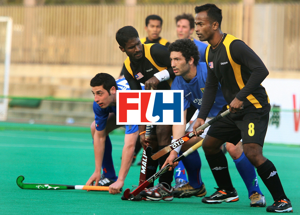 Kakamigahara (Japan):  Selvaraju and Jiwa Mohan being marked closely by Italian defenders in the Olympic Hockey Qualifierat Gifu Perfectural Green Stadium at Kakamigahara on 06 April 2008. Malaysia drew with Italy 4-4.  Photo: GNN/ Vino John