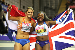 Netherland's Dafne Schippers (left) and Great Britain's Asha Philip celebrates after the Women's 60m final during day two of the European Indoor Athletics Championships at the Emirates Arena, Glasgow.