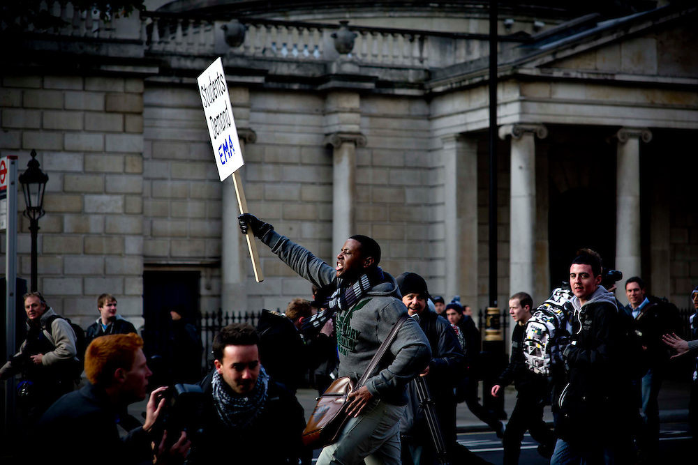 Students protest against government proposals to allow universities to triple tuition fees. The proposed change -- which would see students at English universities charged fees of up to 9,000 pounds a year -- have exposed deep tensions within the Conservative-Liberal Democrat coalition