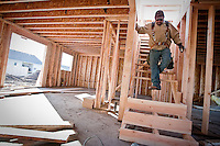 JEROME A. POLLOS/Press..Manny Amparan works on a staircase in a new home Friday at the Fieldstone subdivision in Post Falls.