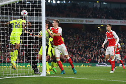 25 October 2016 - EFL Cup - 4th Round - Arsenal v Reading - Liam Moore of Reading heads the ball off the line - Photo: Marc Atkins / Offside.