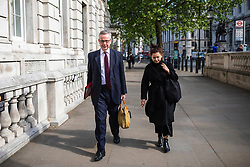 © Licensed to London News Pictures. 07/05/2019. London, UK. Secretary of State for Environment, Food and Rural Affairs Michael Gove (L) arrives at the Cabinet Office on Whitehall for a meeting of the Cabinet. Cross-party talks with Labour on reaching a compromise Brexit deal will resume today. Photo credit: Rob Pinney/LNP