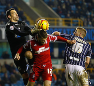 Picture by David Horn/Focus Images Ltd +44 7545 970036<br /> 03/12/2013<br /> David Forde of Millwall catches the ball before Jamie Mackie of Nottingham Forest can head goalwards as Mark Beevers of Millwall looks on during the Sky Bet Championship match at The Den, London.