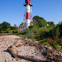 The Conover Beacon, when aligned with the Chapel Hill Rear Range Lighthouse that stands on a hill one a half mile to the south, served to guide vessels along the Chapel Hill Channel. This channel runs from just off the tip of Sandy Hook south into Sandy Hook Bay towards the town of Leonardo.Conover Beacon - Chapel Hill Front Range Light Photograph courtesy U.S. Coast Guard.  In 1852, Congress approved funding for the beacon to be established at Leonardo. The following year, beachfront property was purchased from Rulif Conover, whose name would be applied to the finished tower.