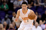 Mar 21, 2016; Phoenix, AZ, USA; Phoenix Suns guard Devin Booker (1) dribbles the ball up the court in the first half of the game against the Memphis Grizzlies at Talking Stick Resort Arena. Mandatory Credit: Jennifer Stewart-USA TODAY Sports