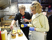 PRICE CHAMBERS / NEWS&amp;GUIDE<br /> Dawnelle Mangum and Ronda Hammer assemble what may be the feature presentation for many, the world-famous Spud Burger.