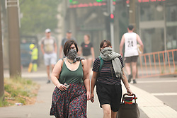 Jan. 2, 2020, Canberra, Australia: Local residents wear facial protections against poor air quality. The country's capital is chocking in smoke from bushfires. According to the Nine News, Canberra's air quality is now the worst out of all major cities in the world. (Credit Image: © Chu Chen/Xinhua via ZUMA Wire)