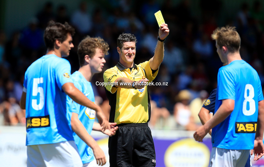 Referee Matt Conger issues a yellow card. ASB Premiership, Auckland City FC v Wanderers SC, Kiwitea Street Auckland, Sunday 9th February 2014. Photo: Shane Wenzlick